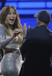 AMERICAN IDOL: Jennifer Lopez gets a surprise from Jimmy Iovine during the season 11 AMERICAN IDOL GRAND FINALE at the Nokia Theatre on Weds. May 23, 2012 in Los Angeles, California. CR: Michael Becker/FOX