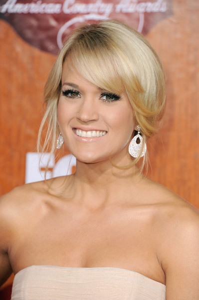 LAS VEGAS, NV - DECEMBER 05:  Singer Carrie Underwood arrives at the American Country Awards 2011 at the MGM Grand Garden Arena on December 5, 2011 in Las Vegas, Nevada.  (Photo by Frazer Harrison/Getty Images) *** Local Caption *** Carrie Underwood;