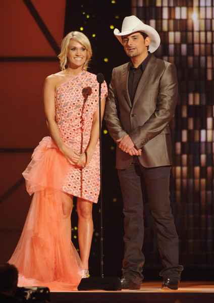 NASHVILLE, TN - NOVEMBER 09:  Hosts Carrie Underwood and Brad Paisley speak at the 45th annual CMA Awards at the Bridgestone Arena on November 9, 2011 in Nashville, Tennessee.  (Photo by Rick Diamond/Getty Images) *** Local Caption *** Carrie Underwood;Brad Paisley;