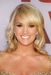 NASHVILLE, TN - NOVEMBER 09: Co host Carrie Underwood attends the 45th annual CMA Awards at the Bridgestone Arena on November 9, 2011 in Nashville, Tennessee. (Photo by Michael Loccisano/Getty Images) *** Local Caption *** Carrie Underwood;