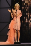 NASHVILLE, TN - NOVEMBER 09: Host Carrie Underwood speaks at the 45th annual CMA Awards at the Bridgestone Arena on November 9, 2011 in Nashville, Tennessee. (Photo by Rick Diamond/Getty Images) *** Local Caption *** Carrie Underwood;