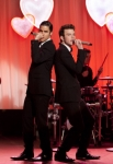 "GLEE: Blaine (Darren Criss, L) and Kurt (Chris Colfer, R) perform at Will and Emma's wedding in the ""I Do"" episode of GLEE airing Thursday, Feb. 14 (9:00-10:00 PM ET/PT) on FOX. ©2013 Fox Broadcasting Co. CR: Adam Rose/FOX"