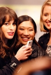 """CR: Andrew Macpherson for TV Guide Magazine Lea Michele checks her phone, with Jenna Ushkowitz (Tina), Dianna Agron (Quinn) and Naya Rivera (Santana). """"It's been the most incredible journey we've gone on with each other,"""" says Agron."""