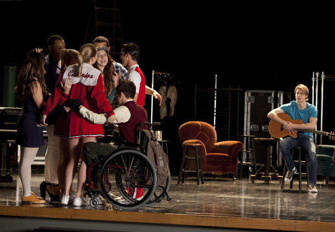 "GLEE: Brittany (Heather Morris, L) gets a group hug in the ""Shooting Star"" episode of GLEE airing Thursday, April 11 (9:00-10:00 PM ET/PT) on FOX. Also Pictured: Chord Overstreet (R).  ©2013 Fox Broadcasting Co. CR: Adam Rose/FOX"