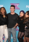 THE X FACTOR: Simon Cowell with Fifth Harmony at THE X FACTOR Final Three Red Carpet and Press Conference, Monday, Dec. 17 in Los Angeles, CA. CR: Ray Mickshaw / FOX.