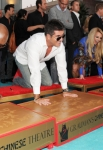 THE X FACTOR: The cast of THE X FACTOR cement their hands in Hollywood's history (L-R): Judges L.A. Reid, Simon Cowell, Britney Spears and Demi Lovato during The Season Two Premiere event of THE X FACTOR on Tuesday, Sept. 11 at Grauman's Chinese Theater in Hollywood, CA.  CR: Frank Micelotta/FOX