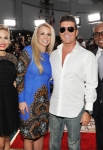 THE X FACTOR: The cast of THE X FACTOR cement their hands in Hollywood's history (L-R): Judges Demi Lovato, Britney Spears, Simon Cowell, and L.A. Reid during The Season Two Premiere event of THE X FACTOR on Tuesday, Sept. 11 at Grauman's Chinese Theater in Hollywood, CA.  CR: Frank Micelotta/FOX