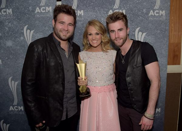 Carrie Underwood & The Swon Brothers-ACM Honors 2014-Photo Credit: Jason Davis, Getty
