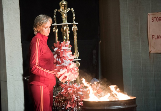 """GLEE: Sue (Jane Lynch) burns pom-poms in the """"The Rise and Fall of Sue Sylvester"""" episode of GLEE airing Friday, March 6 (9:00-10:00 PM ET/PT) on FOX. ©2015 Fox Broadcasting Co. CR: Eddy Chen/FOX"""