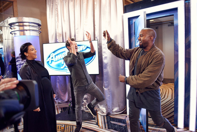 AMERICAN IDOL: Kanye West surpises the Judges and Ryan on American Idol by auditioning in San Francisco. Pictured: Kanye West (R) shows off his golden ticket to Ryan Seacrest (C) and Kim Kardashian. AMERICAN IDOL will begin its 15th – and farewell – season with a special two-night, four-hour premiere event Wednesday, Jan. 6 (8:00-10:00 PM ET/PT) and Thursday, Jan. 7 (8:00-10:00 PM ET/PT) on FOX. AMERICAN IDOL XV continues on Wednesdays (8:00-9:00 PM ET/PT) and Thursdays (8:00-10:00 PM ET/PT).  © 2016 Fox Broadcasting Co. Cr: Michael Becker / FOX.
