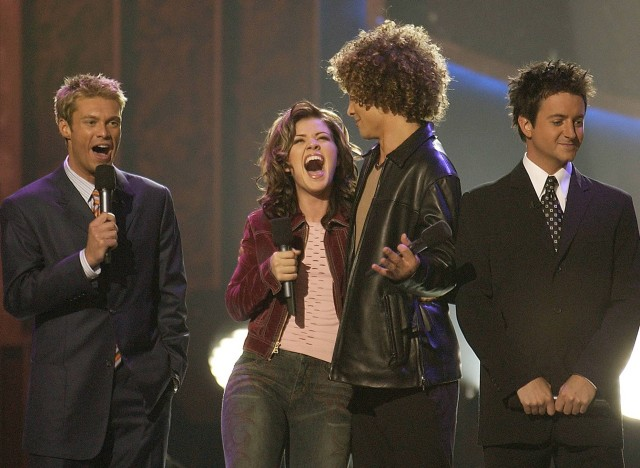 (L-R):Ryan Seacrest, Kelly Clarkson, Justin Guarini and BrianDunkleman find out who is America's Idol Wednesday, Sept. 4, 2002, at the Kodak Theater in Hollywood, CA, on the finale of AMERICAN IDOL:THE SEARCH FOR A SUPERSTAR on FOX. ??2002FOX BROADCASTING CR:Ray Mickshaw/FOX