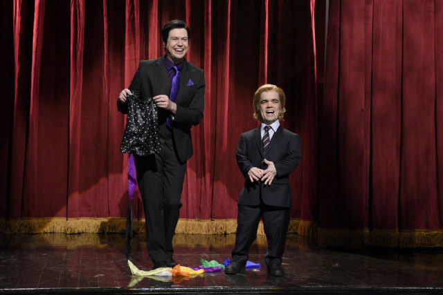"""SATURDAY NIGHT LIVE -- """"Peter Dinklage"""" Episode 1699 -- Pictured: (l-r) Taran Killam and Peter Dinklage as Mr. Peterson during the """"Corporate Magic Show"""" sketch on April 2, 2016 -- (Photo by: Dana Edelson/NBC)"""