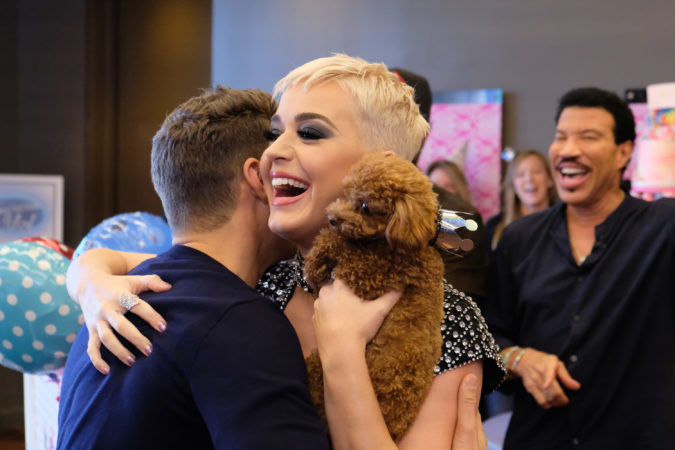"""AMERICAN IDOL - As """"American Idol"""" auditions continued this week in the heart of Music City, celebrity judges Luke Bryan and Lionel Richie, along with host Ryan Seacrest, surprised Katy Perry with a puppy themed party in honor of her upcoming birthday. (ABC/Mark Levine) RYAN SEACREST, KATY PERRY, LIONEL RICHIE"""
