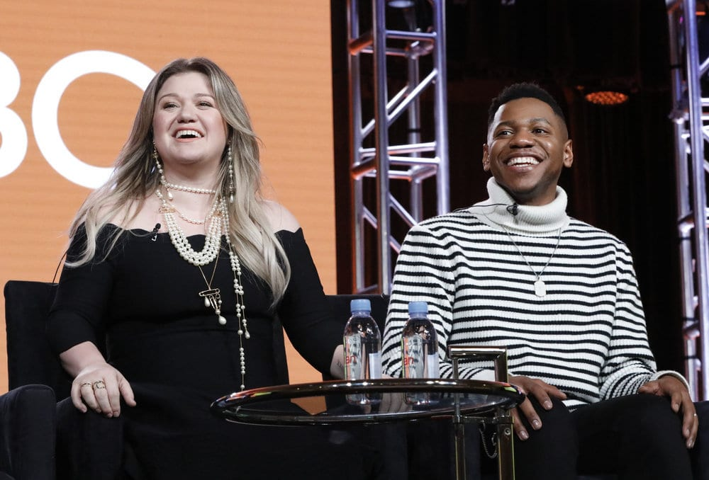 "NBCUNIVERSAL EVENTS -- NBCUniversal Press Tour, January 2018 -- NBC's ""The Voice"" Session -- Pictured: (l-r) Kelly Clarkson, Coach; Chris Blue, Season 12 Winner -- (Photo by: Evans Vestal Ward/NBCUniversal)"
