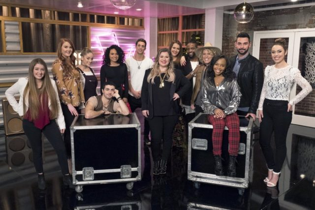 "THE VOICE -- ""Battle Reality"" -- Pictured: Team Kelly (l-r) Alexa Cappelli, Hannah Goebel, Brynn Cartelli, Dylan Hartigan, Jamella, Jorge Eduardo, Kelly Clarkson, Amber Sauer, D.R. King, Molly Stevens, Teana Boston, Justin Kilgore, Jackie Foster -- (Photo by: Colleen Hayes/NBC)"