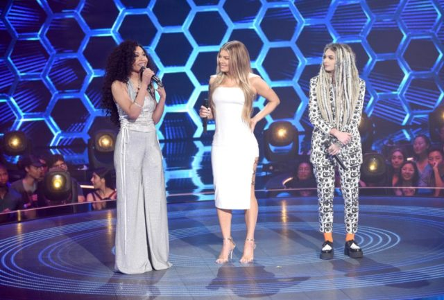 "THE FOUR: BATTLE FOR STARDOM: L-R: Season one winner Evvie McKinney, host Fergie and season one contestant Zhavia in the ""Week Seven"" episode of THE FOUR: BATTLE FOR STARDOM airing Thursday, July 26 (8:00-10:00 PM ET/PT) on FOX. CR: Ray Mickshaw / FOX. © 2018 FOX Broadcasting Co."