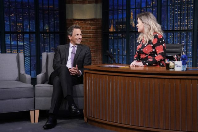 LATE NIGHT WITH SETH MEYERS -- Episode 736 -- Pictured: (l-r) Host Seth Meyers gets interviewed by singer Kelly Clarkson on September 20, 2018 -- (Photo by: Lloyd Bishop/NBC)
