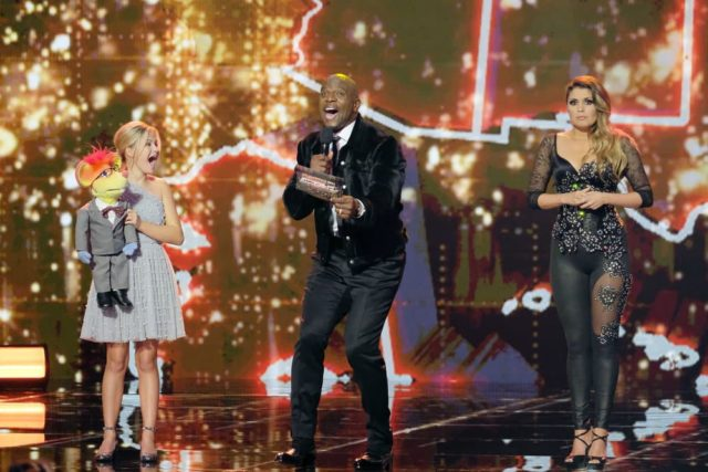 """AMERICA'S GOT TALENT: THE CHAMPIONS -- """"The Champions Two"""" Episode 102 -- Pictured: (l-r) Darci Lynne, Terry Crews. Cristina Ramos -- (Photo by: Trae Patton/NBC)"""