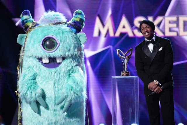"THE MASKED SINGER: L-R: Monster and host Nick Cannon in the special two-hour ""Road to the Finals / Season Finale: The Final Mask is Lifted"" season finale episode of THE MASKED SINGER airing Wednesday, Feb. 27 (8:00-10:00 PM ET/PT) on FOX. © 2019 FOX Broadcasting. CR: Michael Becker / FOX."