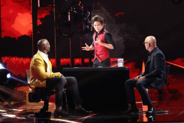 """AMERICA'S GOT TALENT: THE CHAMPIONS -- """"The Champions Finals"""" Episode 106 -- Pictured: (l-r) Terry Crews, Shin Lim, Howie Mandel -- (Photo by: Jordin Althaus/NBC)"""