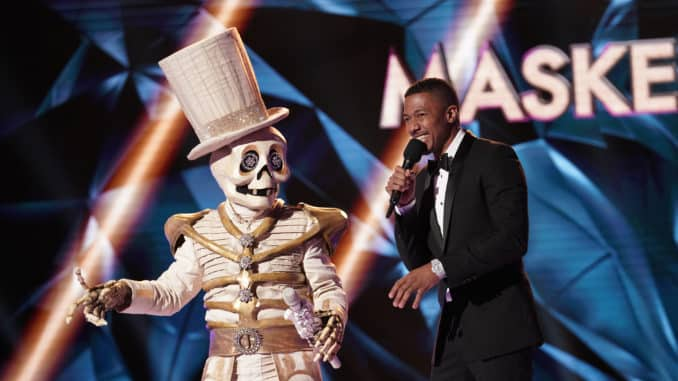 """THE MASKED SINGER: L-R: The Skeleton and host Nick Cannon in the """"Season Two Premiere"""" episode of THE MASKED SINGER airing Wednesday, Sept. 25 (8:00-10:00 PM ET/PT) on FOX.. © 2019 FOX MEDIA LLC. CR: Michael Becker / FOX."""