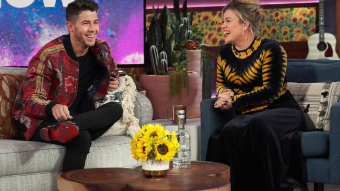 THE KELLY CLARKSON SHOW -- Episode 3053 -- Pictured: (l-r) Nick Jonas, Kelly Clarkson -- (Photo by: Adam Christopher/NBCUniversal)