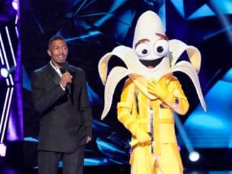 THE MASKED SINGER: L-R: Host Nick Cannon and The The Banana in the ?A Brand New Six Pack: Group B Kickoff!? episode of THE MASKED SINGER airing Wednesday, Feb 19 (8:00-9:01 PM ET/PT) on FOX. © 2020 FOX MEDIA LLC. CR: Greg Gayne / FOX.