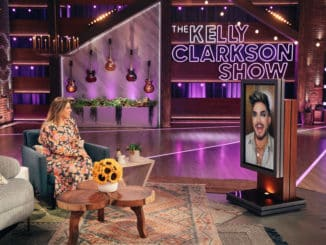 THE KELLY CLARKSON SHOW -- Episode 4090 -- Pictured: (l-r) Kelly Clarkson, Adam Lambert (on screen) -- (Photo by: Weiss Eubanks/NBCUniversal)