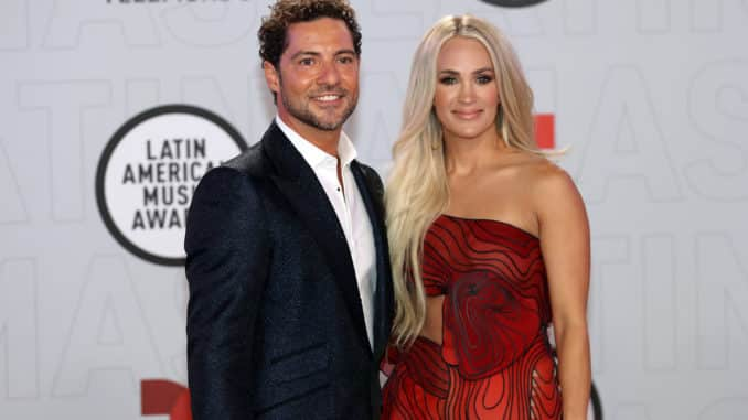 """2021 LATIN AMERICAN MUSIC AWARDS -- """"Red Carpet"""" -- Pictured: (l-r) David Bisbal and Carrie Underwood at the BB&T Center in Sunrise, FL on April 15, 2021 -- (Photo by: Aaron Davidson/Telemundo)"""