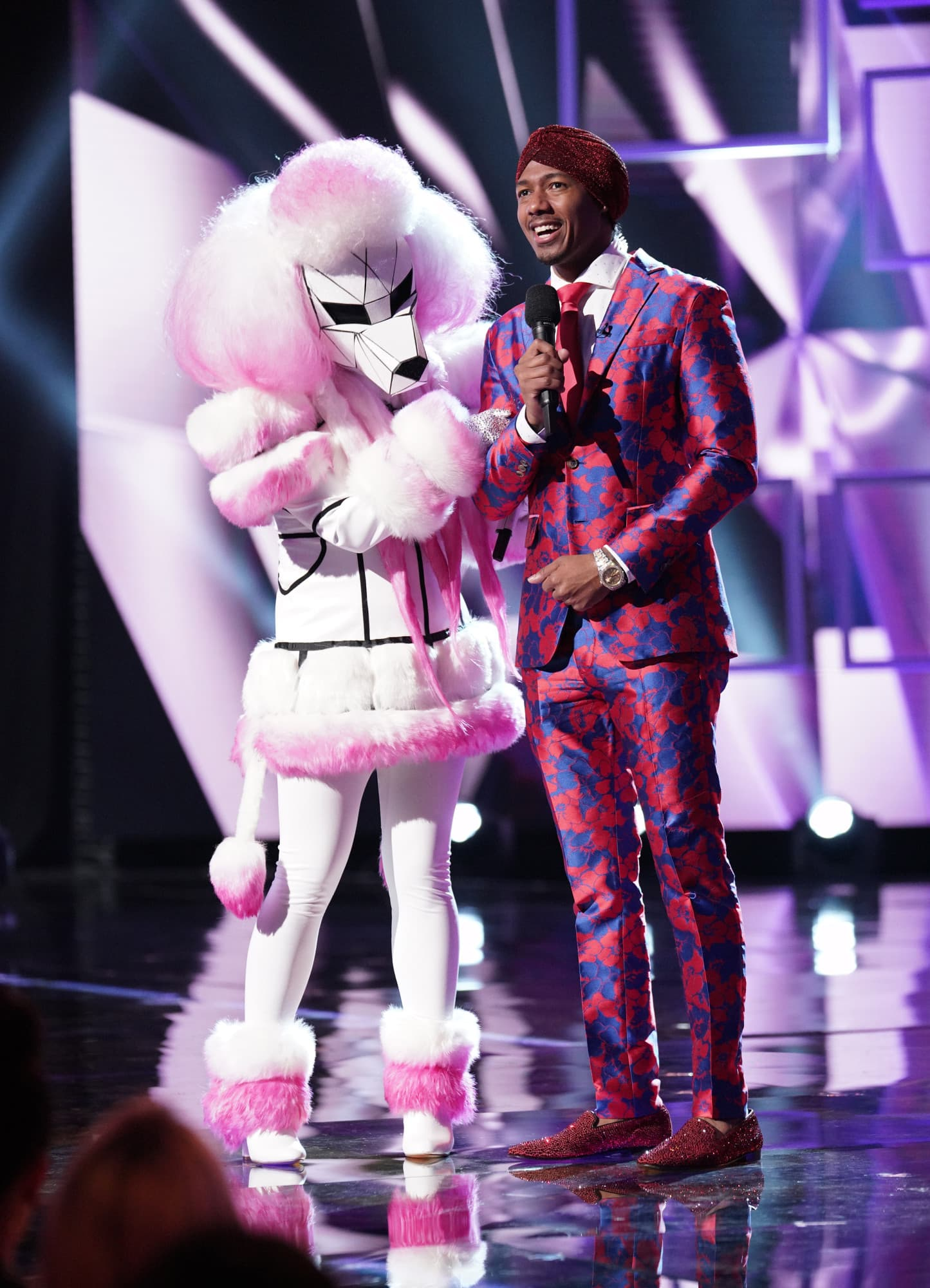 "THE MASKED SINGER: L-R: Poodle and host Nick Cannon in the ""Another Mask Bites the Dust"" airing Wednesday, Jan. 23 (9:00-10:00 PM ET/PT) on FOX. © 2019 FOX Broadcasting.  Cr: Michael Becker / FOX."