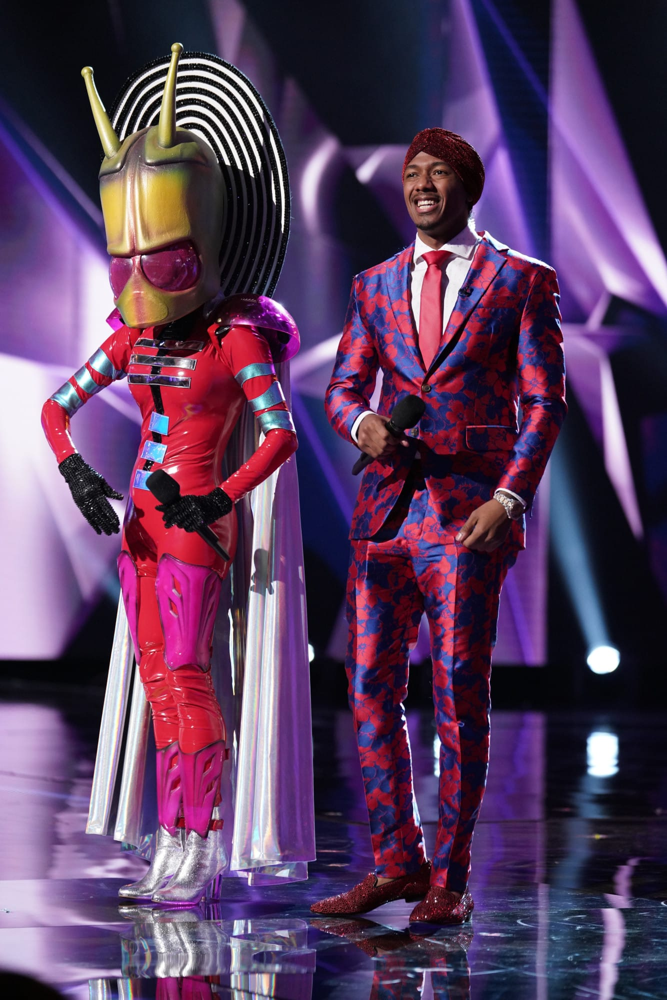 "THE MASKED SINGER: L-R: Alien and host Nick Cannon in the ""Another Mask Bites the Dust"" airing Wednesday, Jan. 23 (9:00-10:00 PM ET/PT) on FOX. © 2019 FOX Broadcasting.  Cr: Michael Becker / FOX."