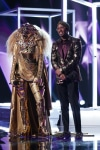 """THE MASKED SINGER: L-R: Lion and host Nick Cannon in the """"All Together Now"""" episode of THE MASKED SINGER airing Wednesday, Feb. 13 (9:00-10:00 PM ET/PT) on FOX. © 2019 FOX Broadcasting. Cr: Michael Becker / FOX."""